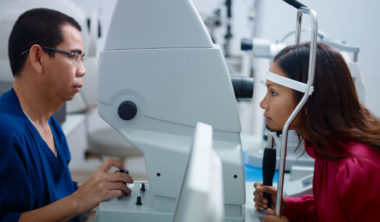 eyesight-exam-in-clinic-with-asian-doctor-and-PRBFRT5