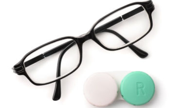 top-view-of-eyeglasses-and-eye-contact-lenses-PHPWN4U